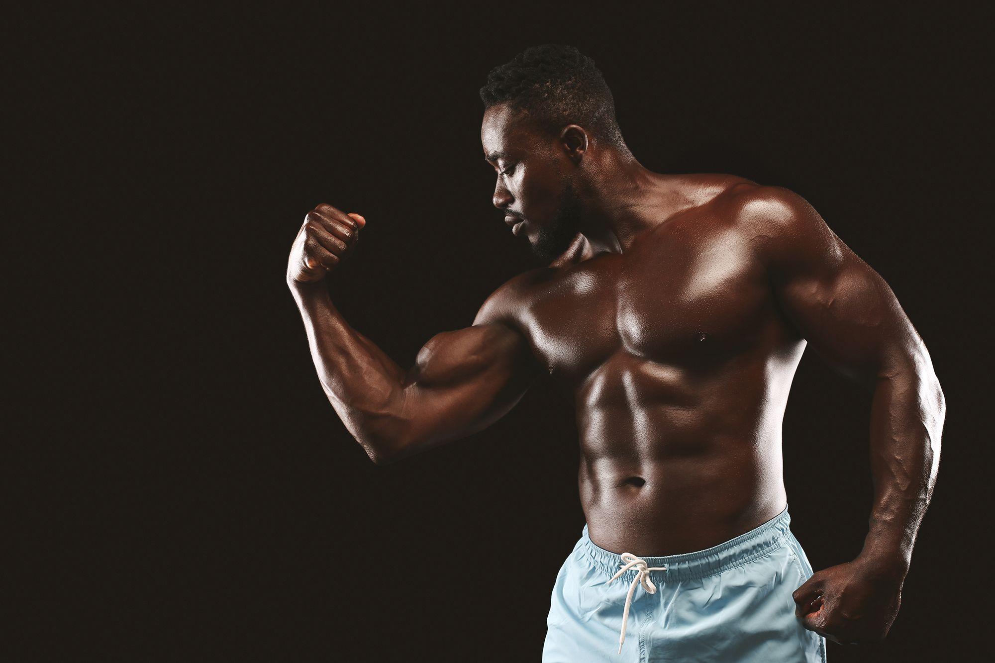 bodybuilder demonstrating his biceps