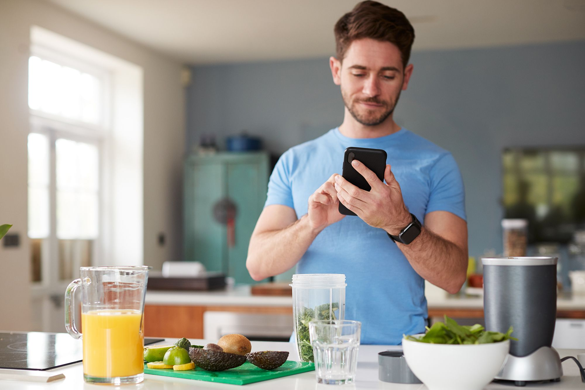 man using fitness tracker to count calories